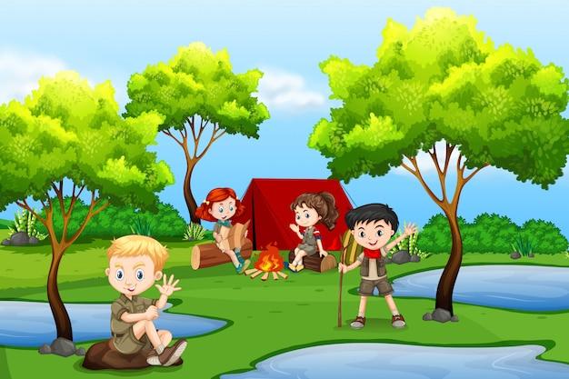 Camping crianças na floresta Vetor Premium