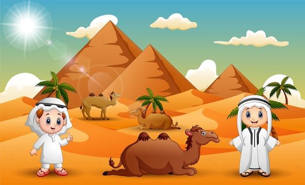 Caravanas estão pastoreando camelos no deserto Vetor Premium