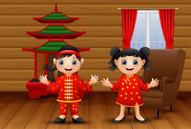 Caricatura, chinês, crianças, em, a, sala de estar Vetor Premium