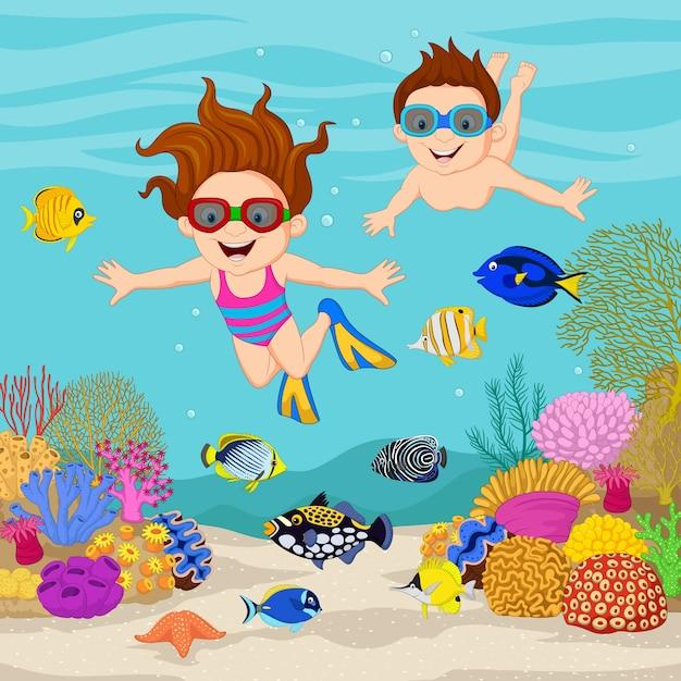 Caricatura, crianças, mergulhar, sob, a, oceano tropical Vetor Premium