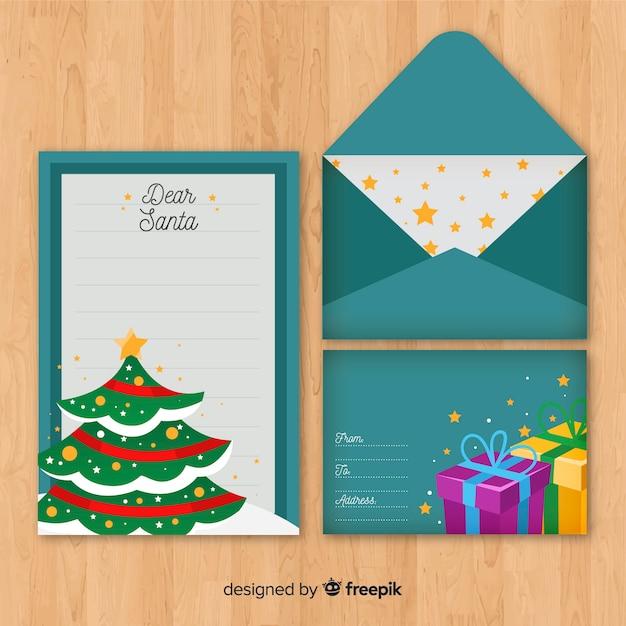 Carta de natal com envelope Vetor grátis