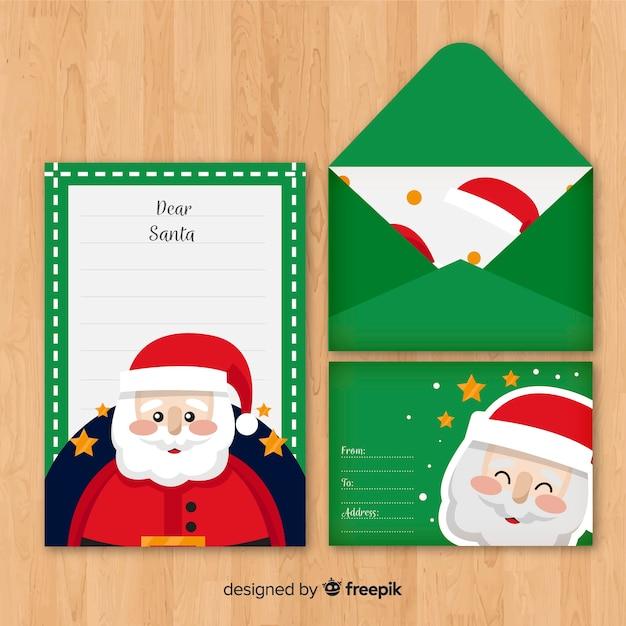 Carta de natal e envelope com santa Vetor grátis