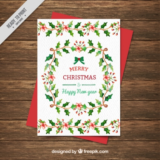 Cartão da aguarela do Natal com elementos florais Vetor grátis