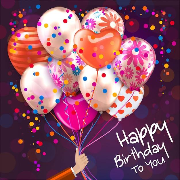 Cartão de aniversário com a mão segura balões coloridos Vetor Premium