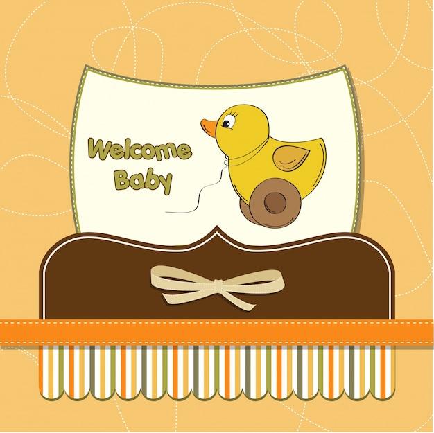Cartão de bebê de boas-vindas com brinquedo de pato Vetor grátis