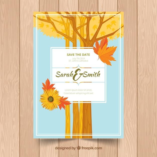Cartão de casamento com árvores, folhas e flores Vetor grátis