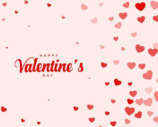 Cartão de desejos de dia dos namorados com corações espalhados Vetor grátis