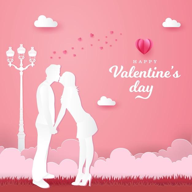 Cartão de dia dos namorados. casal romântico beijando e de mãos dadas na rosa Vetor Premium