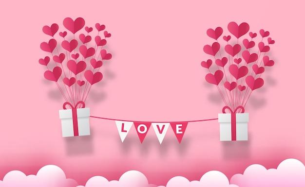 Cartão de dia dos namorados com balão de amor de coração e caixa de presente estilo corte de papel Vetor Premium