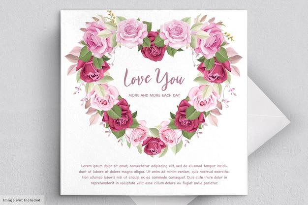 Cartão de dia dos namorados com lindos florais e folhas Vetor grátis