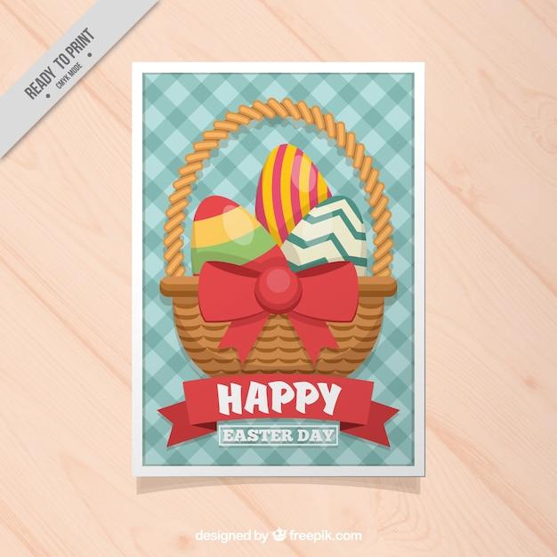 Cartão de easter quadriculada com cesta e ovos Vetor grátis