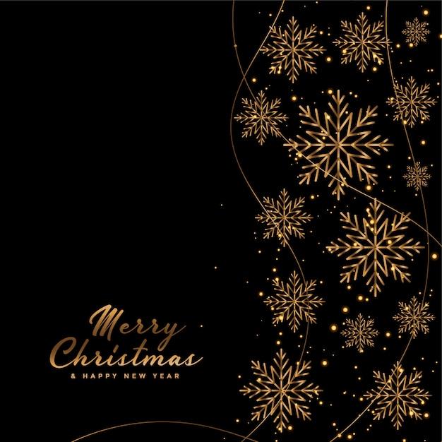 Cartão de feliz natal preto com flocos de neve dourados Vetor grátis