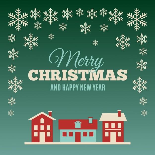 Cartão de natal com casas e flocos de neve Vetor grátis