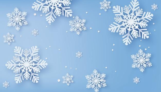 Cartão de natal com papel cortado floco de neve Vetor Premium