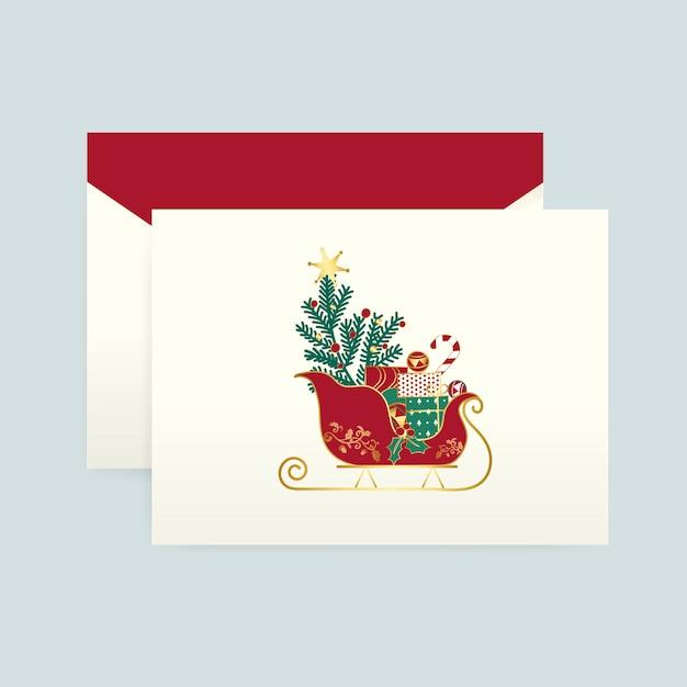 Cartão de natal com um vetor de envelope Vetor grátis