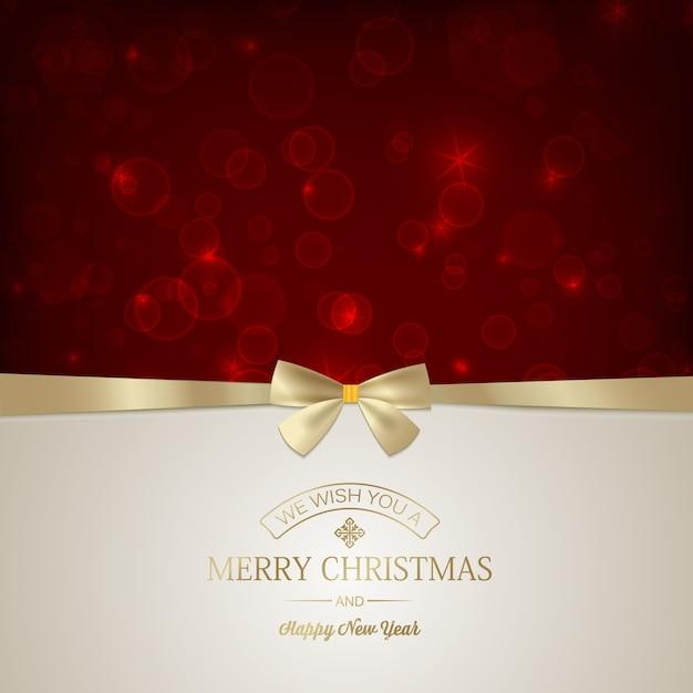 Cartão festivo de feliz natal com inscrição e laço de fita dourada em estrelas vermelhas brilhantes. Vetor grátis