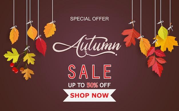 Cartão marrom com folhas de outono pendurado em um fio Vetor Premium