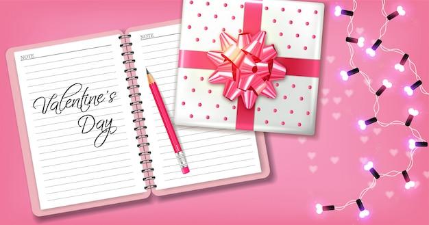 Cartão romântico rosa com caixa de presente e guirlanda Vetor Premium