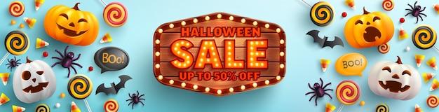 Cartaz de venda de halloween e modelo de banner com uma linda abóbora de halloween e doces Vetor Premium