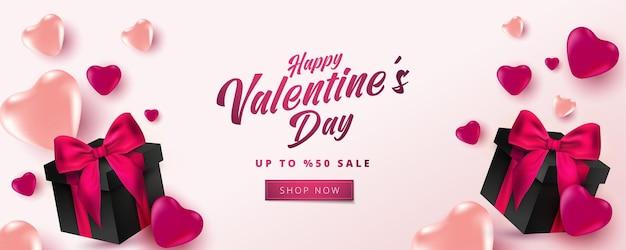 Cartaz de venda do dia dos namorados ou banner com corações e caixa de presente realista em fundo rosa suave. Vetor Premium