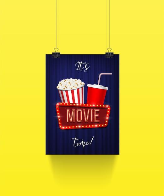 Cartaz pendurado em clipes de papel com balde de pipoca e copo de refrigerante com placa de filme Vetor Premium