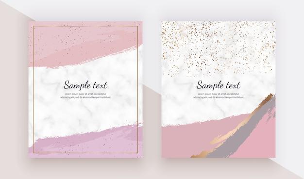 Cartões com pincel aquarela rosa derrame confete de textura, ouro sobre a textura de mármore. Vetor Premium