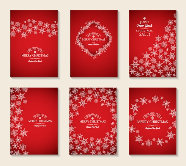 Cartões de natal e ano novo com inscrições e flocos de neve elegantes em vermelho Vetor grátis