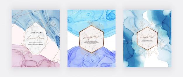 Cartões de tinta álcool rosa e azul com folhas de ouro e quadros de linhas poligonais. resumo mão pintado o fundo. projeto de pintura de arte fluida. Vetor Premium