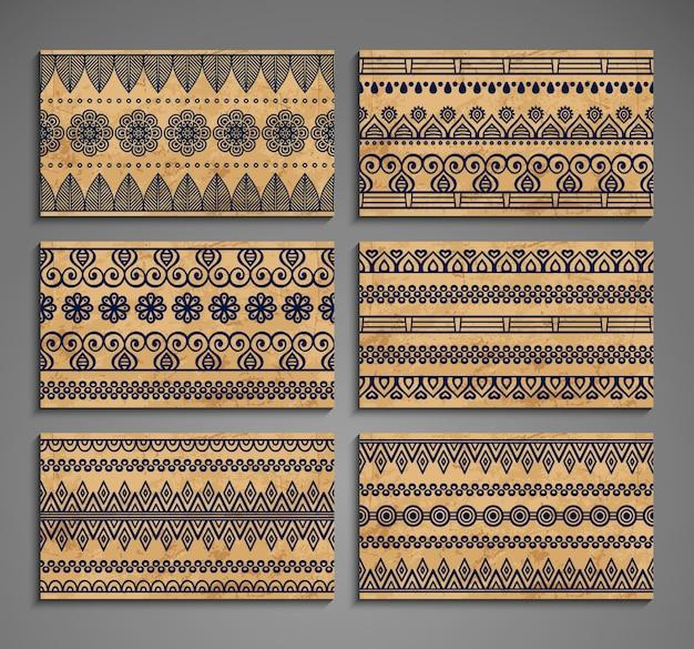 Cartões étnicos com ornamentos Vetor grátis