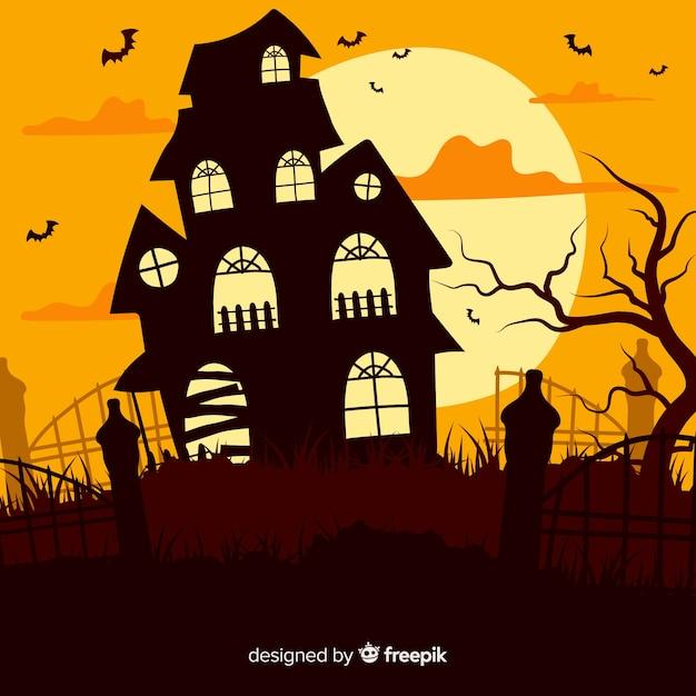 Casa assombrada de halloween ao entardecer Vetor grátis