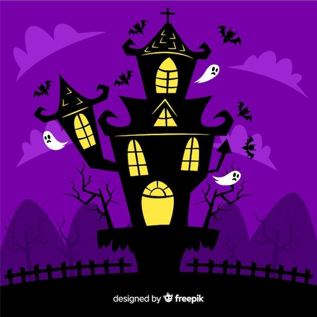Casa assombrada halloween plana por fantasmas Vetor grátis