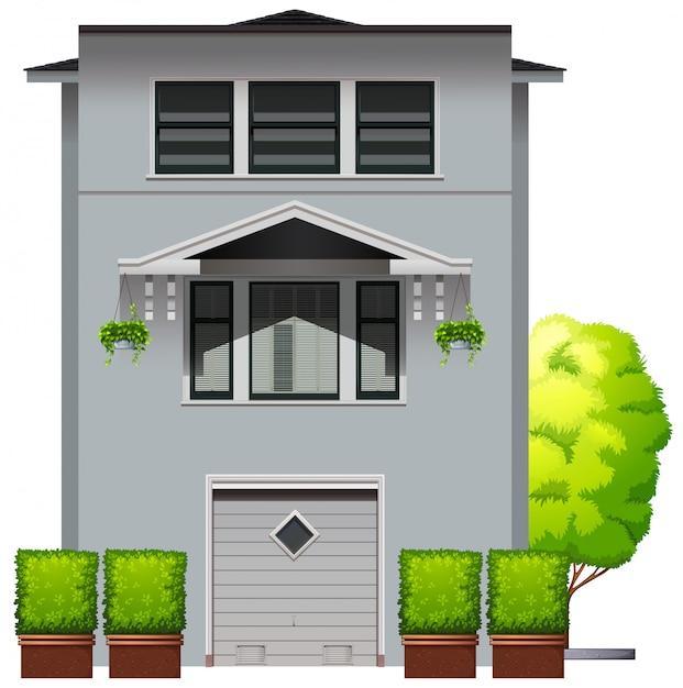 Casa cinza com plantas e árvores Vetor grátis