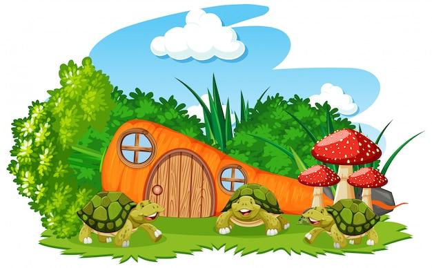 Casa de cenoura com três tartarugas cartum estilo sobre fundo branco Vetor grátis