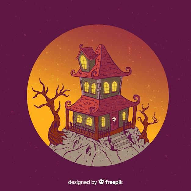 Casa de desenhos animados de halloween na colina Vetor grátis