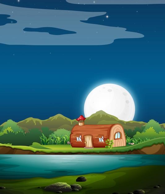 Casa de madeira encantada à noite Vetor grátis