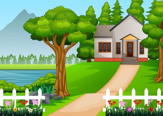 Casa na bonita aldeia com quintal verde cheio de flores Vetor Premium