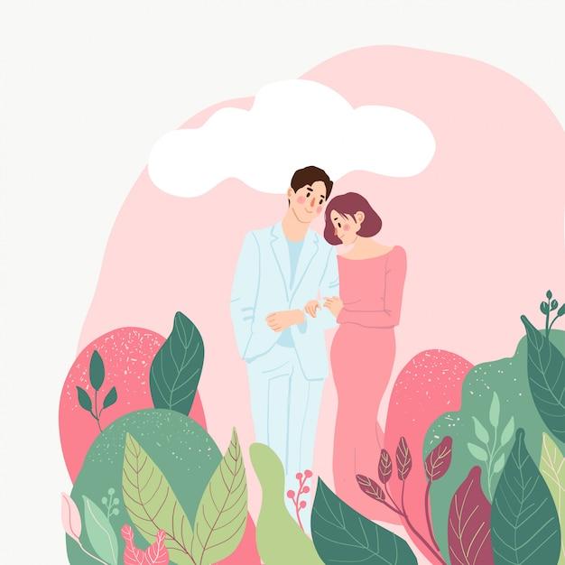 Casal apaixonado, rodeado de folhas Vetor Premium