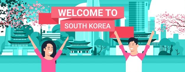 Casal coreano sobre a cidade de seul Vetor Premium