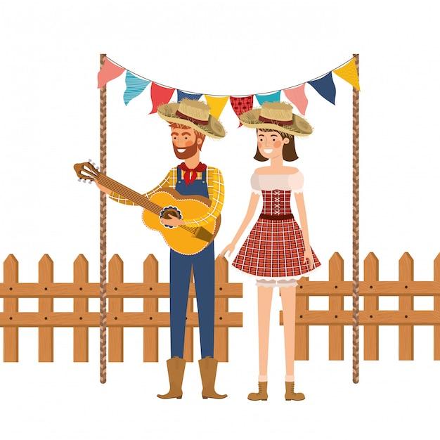 Casal de agricultores com instrumento musical Vetor grátis