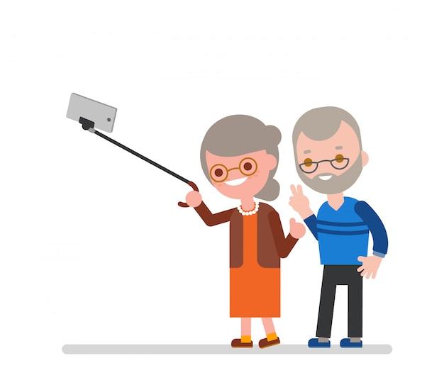Casal de idosos tomando selfie com bengala. vovó feliz vovô tirando foto usando o smartphone. ilustração em vetor personagem dos desenhos animados. Vetor Premium