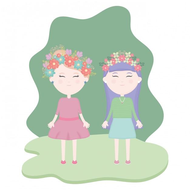 Casal de miúdas giras com coroa floral no cabelo no campo Vetor grátis