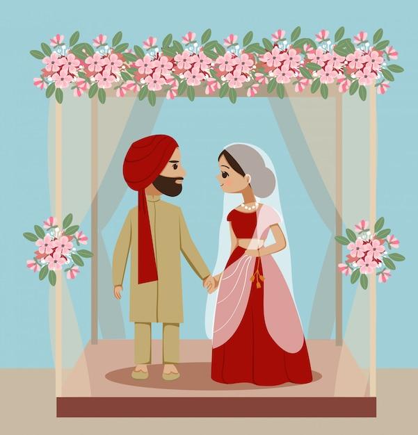 Casal de noivos indiano sob decoração mandaps Vetor Premium