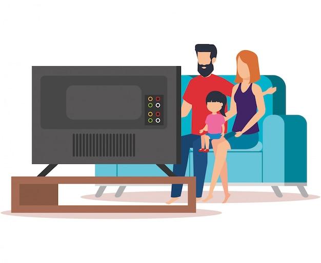 Casal de pais com filha waching tv Vetor grátis