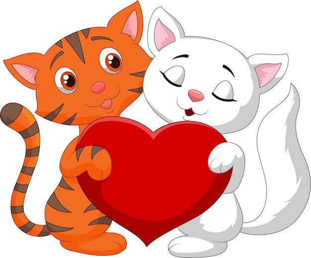 Casal feliz gato segurando coração vermelho Vetor Premium