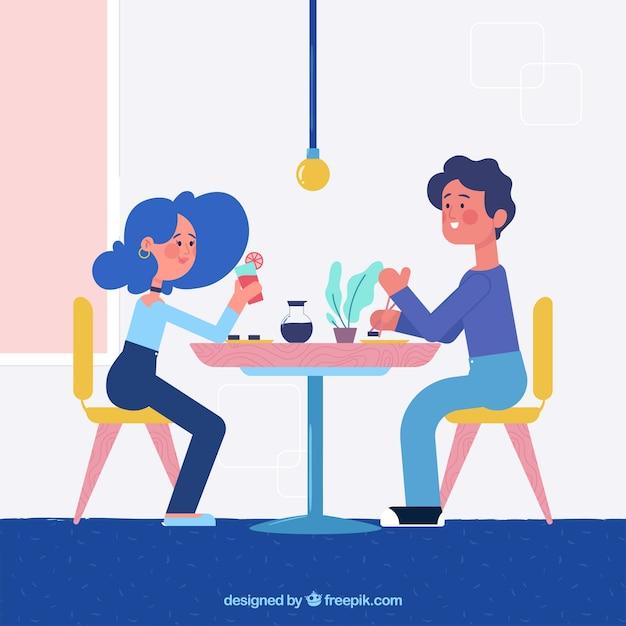 Casal jovem jantando no restaurante Vetor grátis