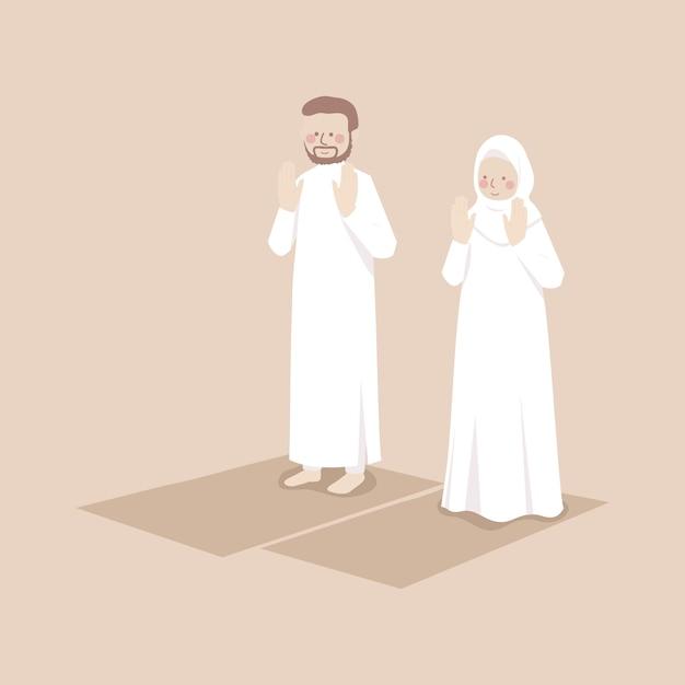Casal muçulmano levanta as mãos para fazer takbirat al ihram em oração, orando juntos em posição no tapete de oração Vetor Premium