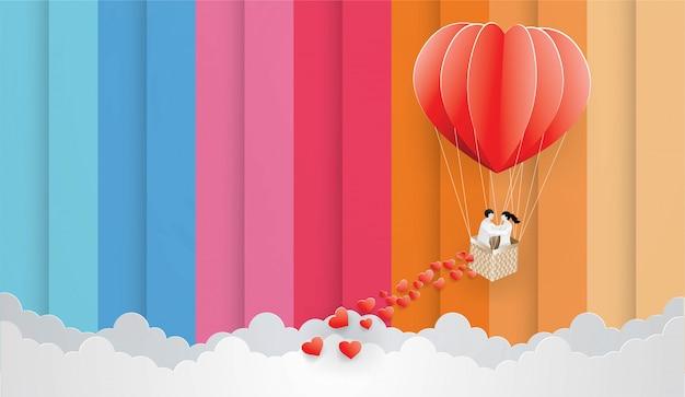 Casal no balão vermelho sobre o fundo do céu de cor. Vetor Premium