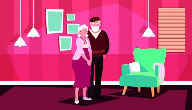 Casal velho bonito em casa dentro Vetor Premium