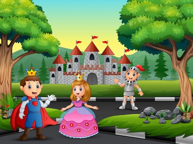 Cavaleiro com princesa e príncipe na estrada para o castelo Vetor Premium