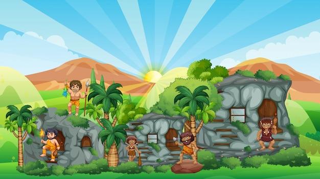 Caverna pessoas que vivem na casa de pedra Vetor grátis